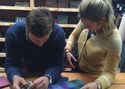 Nicola and John Sugden browsing Harris Tweed patterns