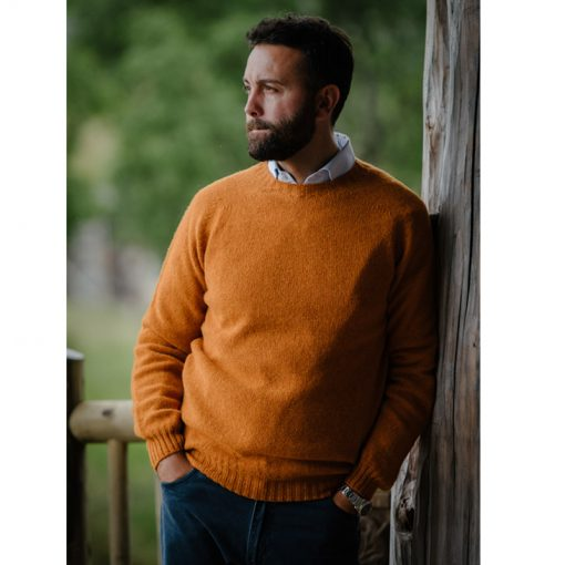 model wearing orange jumper