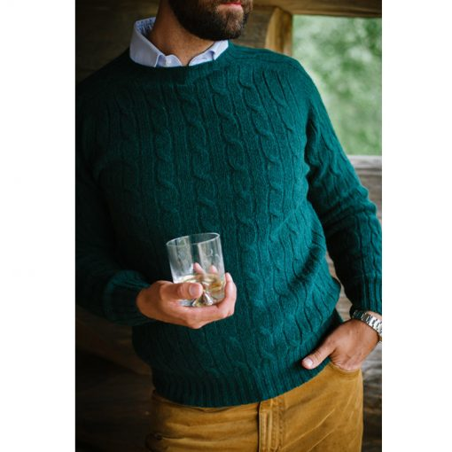model wearing green cable knit