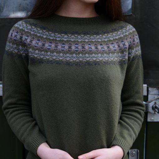 model wearing green fairisle jumper