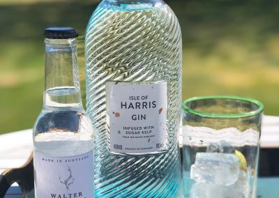 bottle of harris gin with tonic