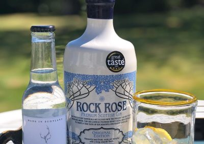 bottle of rock rose gin with tonic