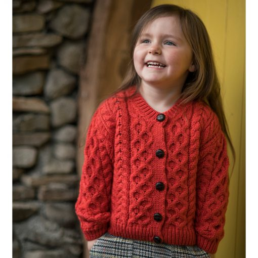 child wearing coral cardigan