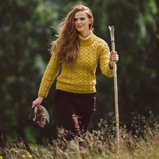 model wearing yellow aran jumper